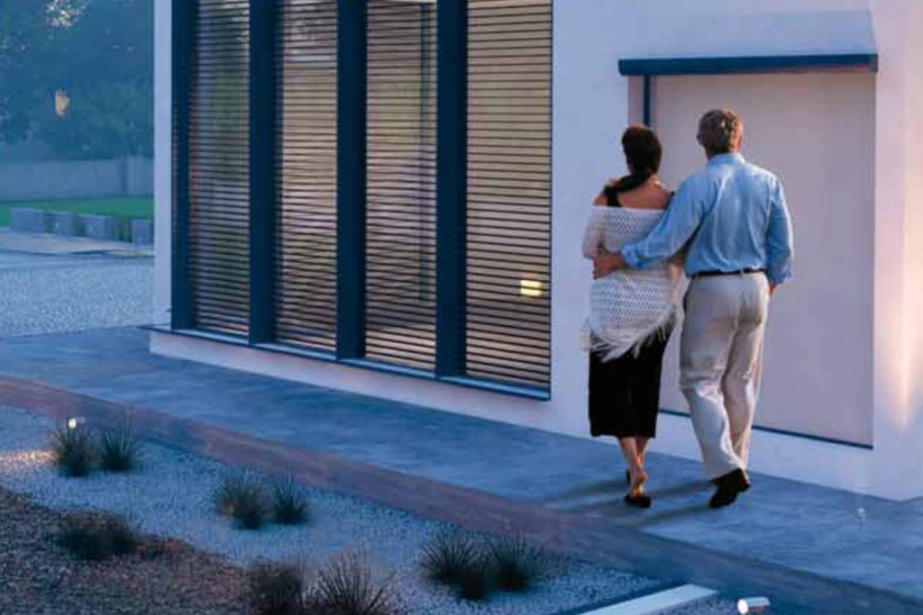 Couple walking next to building secured by BTicino video door entry system